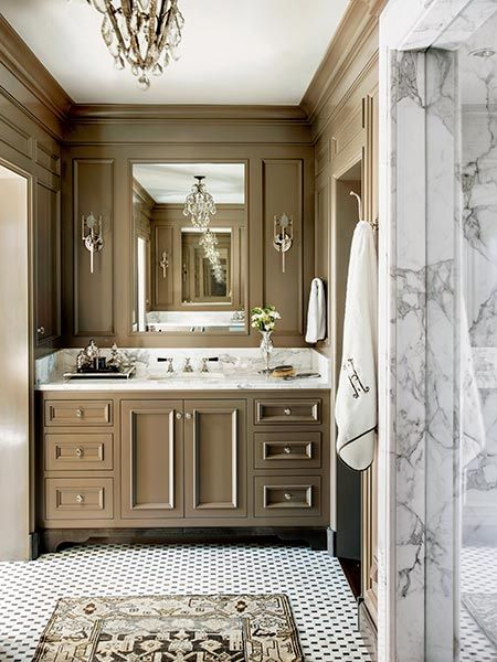 Interior designer Barbara Westbrook painted this bath a luxurious shade of taupe. Covering the walls and all the woodwork in the space, the color is an invitation to relax.