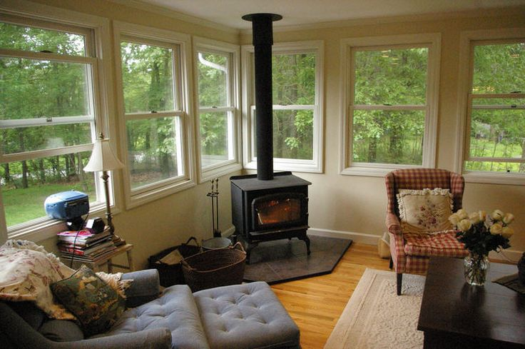 Woodstove in sunroom wood stove ideas pinterest the for Small enclosed deck ideas