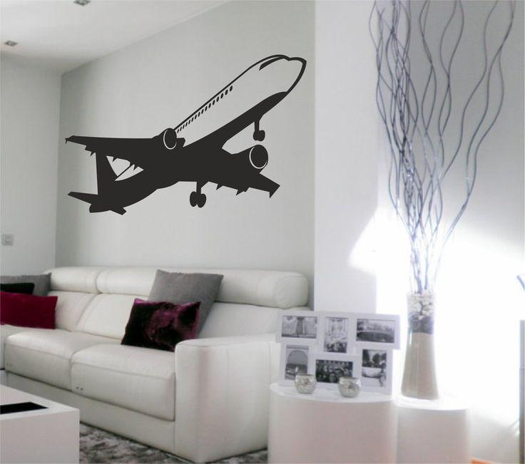 Vinilo decorativo de un avión comercial surcando el cielo.