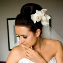 A sleek Audrey Hepburn bridal up-do style.