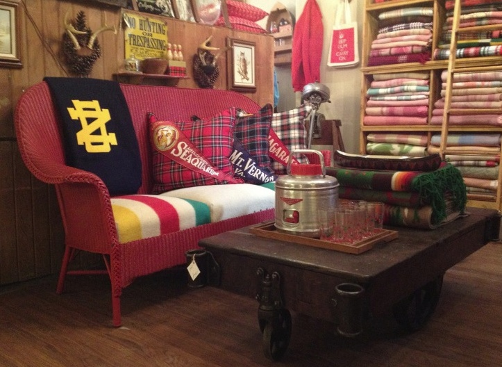 pillows covered in vintage blankets with vintage pennants stitched on them.  They're at a shop in Chicago called Brimfield. - 42 Best Chicago Furniture Consignment, Antique, Warehouse, And
