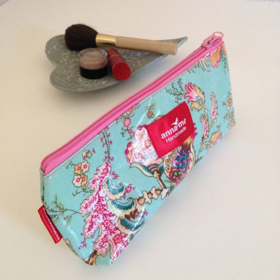 This pretty floral small makeup bag has a waterproof lining, and the cotton canvas is sealed in PVC, making it easy to clean and perfect for traveling! Visit the Anna Me store on Etsy for worldwide sales. #makeup #cosmetics #etsy #pouch #pretty #floral