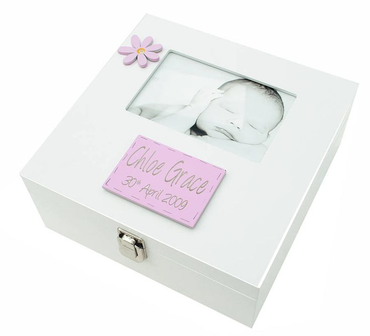 "This wooden keepsake box has a glass frame on top of the lid to fit a 6x4'' photo. Also available as Boys memory Box with Photoframe but with a blue personalised engraving plaque and blue flowers Also avalable in a larger size with a 7x5"" photo frame. It can be personalised with two names and a date, this is included in the price. We can personalise it with a plaque underneath the photo and is ideal for any special occassion (New Baby, weddings, special birthdays, First Holy Communion, ..."
