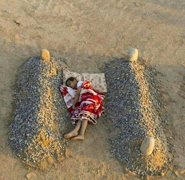 In Syria, Sleeping between his parents.