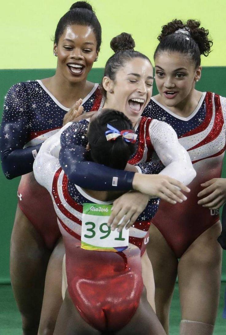 Image forward roll jpg gymnastics wiki - Gymnast Aly Raisman Center Hugs Teammate Simone Biles As Gabby Douglas Back Left