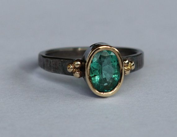 Size 6.5 hammer forged sterling silver ring. The stone is a high quality natural 1.34 ct medium green Zambian emerald (panna stone). The band is a