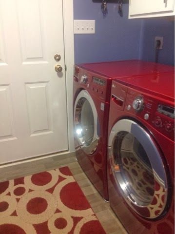 Laundry room - Valspar Merlin, vinyl wood floor from Lowe's. LG red washer and dryer.