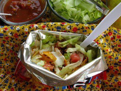 """Walking Tacos"" -- add chopped meat (or not), beans, chopped tomatoes, lettuce, and salsa to individual bags of corn chips."