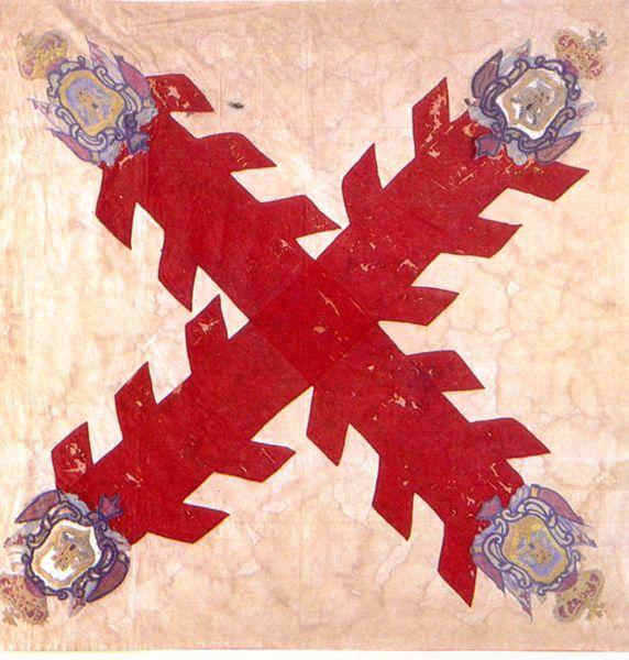 Pendón utilizado durante el Virreinato, el escudo de la Cruz de Borgoña o de San Andrés, rematada con cuatro escudos, dos leones y dos castillos.