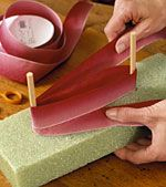 Bow making trick - so simple & they are perfect! move the dowels wider for larger bows, closer for smaller bows.