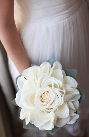 The best white bouquet I've ever seen - so neat! This is a composite bouquet- a handmade, white rosette made of vendela roses. It is made of one full rose head and finished with lots of rose petals to give the appearance of a giant, garden style rosette and has an eucalyptus-leaf border.""