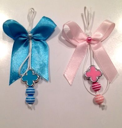 Martyrika or witness pins are small lapel ribbons handed out at the end of the ceremony and worn by guests as proof of witnessing the baptism. The traditional pin is made of white, pink or blue ribbon and features a tiny cross or icon in the center. Personalization of the martyrika is optional. #WitnessPins #Martyrika #Baptism