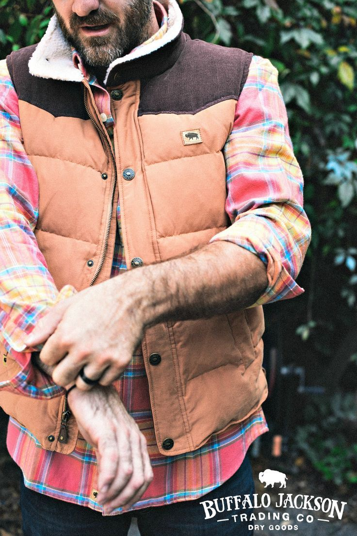 A vintage American vest with cowboy virtues. Not too puffy. Sherpa collar and corduroy trim. Great fit for layering. Classic, rugged men's fashion.