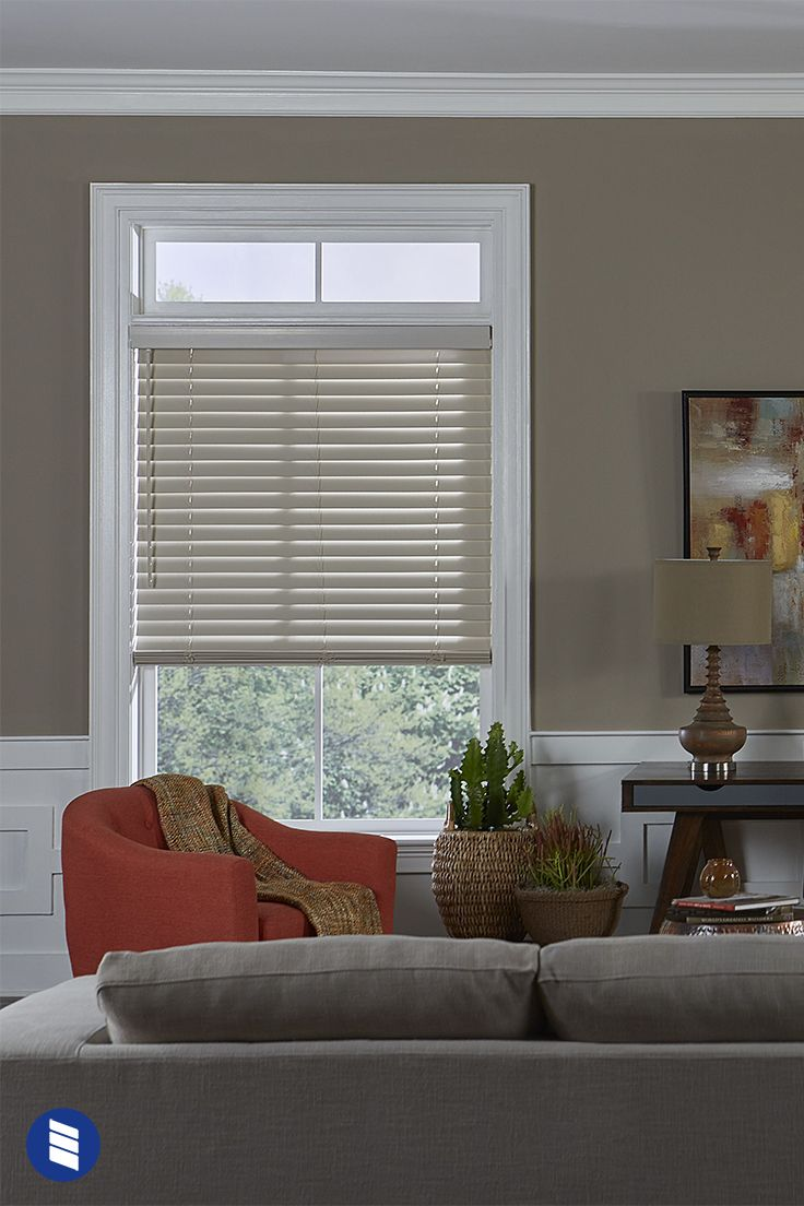 Give Your Living Room Windows An Inviting Feel With Wood Blinds In Antique White