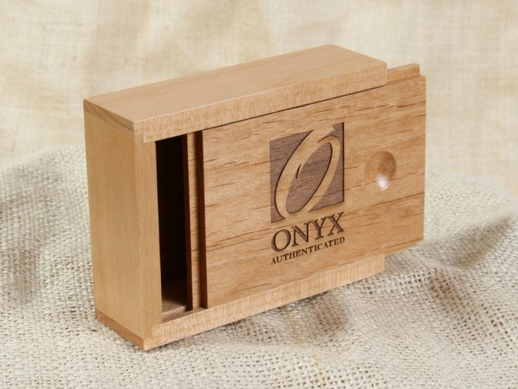 This sliding top custom wooden box was made by WDI for Onyx Authenticated.