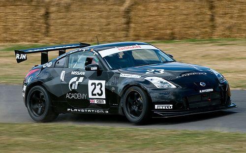 'Lifting a wheel' - 2004 Nissan 350Z GT4 race car at the 2009 Goodwood FoS