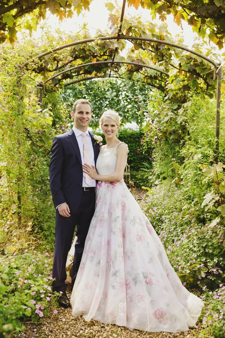"In June 2016, Laura and Roland married at Birtsmorton Court—famed for its exquisite formal gardens—in Worcestershire, England. The bride looked like a true English rose in her Sassi Holford ""Marilyn"" gown, complete with organza overlay and shoulder detailing."