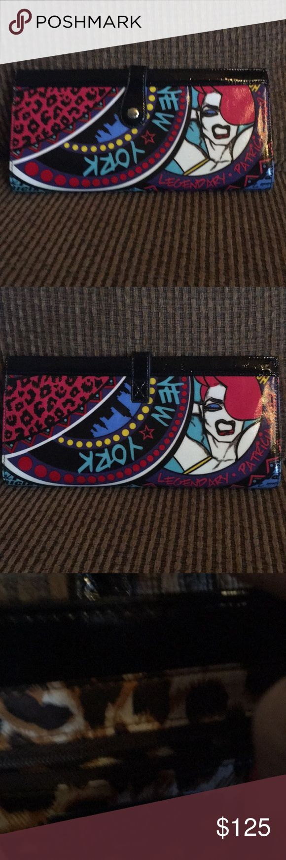 Rare Patricia Field Magazine clutch ! Excel cond Rare Patricia Fields magazine clutch excellent condition made famous by sex and the city  she was designer. Has one zip closure inside. Carried once. Patricia Field Bags Clutches & Wristlets