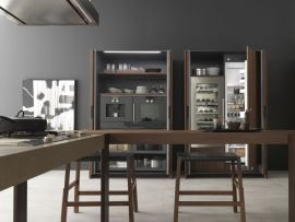 11. This new style proposes to evolve the minimalism: from the contact to object intended as simplicity and clearness of shapes to the recovery of rationalism and functionality, tied to the real qualities and to the materials that characterise the kitchen. (2/3)