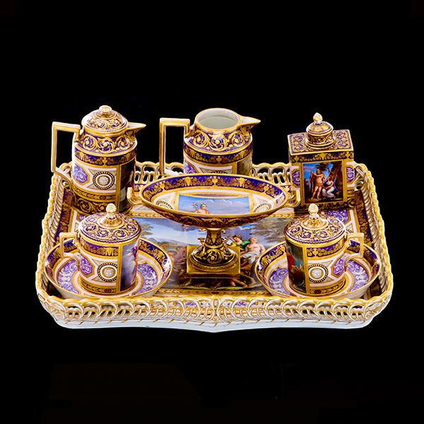 Lavender-Ground Tea Set This nine piece tea set is known as a tête-á-tête because it was designed for two people. It includes a rectangular tray, a teapot, a wide shallow dish, known as a tazza, two cups and saucers with covers, a tea canister and a milk jug. Each piece is decorated with scenes from the life of mythological characters, including, Zeus and Ganymede, Theseus and the Minotaur, Hercules and Hermes. It was made at The Royal Vienna Factory which operated under various guises
