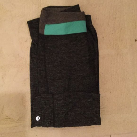 Lululemin Groove Pant Classic yoga pants. Dark gray with turquoise at the waist. Fold Down or high waist. lululemon athletica Pants Leggings