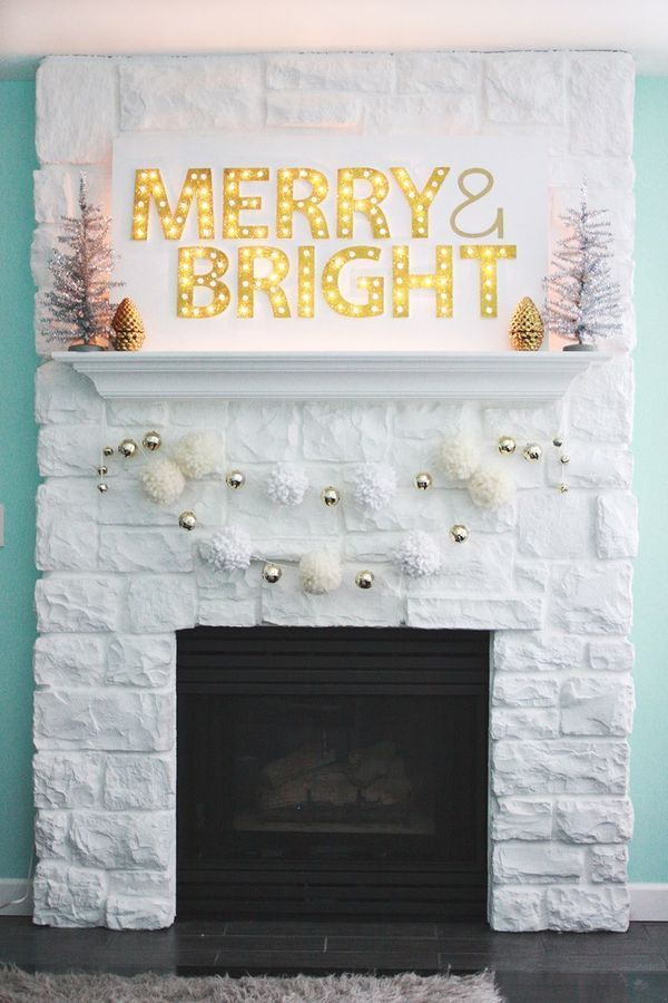 Marquee light mantel decor for Christmas: Do you have a fireplace or bookshelf in your dining room? Decorate it with marquee lighting in a holiday message. Hang garland beneath it, or surround it with bottle brush trees. | 10 Ways to Decorate Your Holiday Table