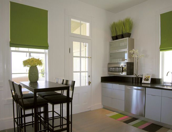 This lime green custom roman shade cuts down on heavy sun in this sunny NOPA, San Francisco kitchen