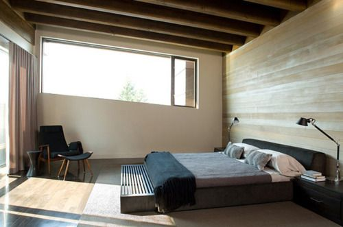 I love low beds like this. And simple, huge windows.