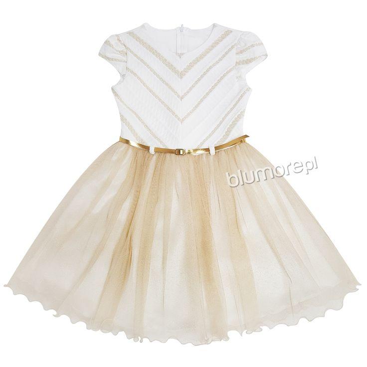 Twoje dziecko lubi kreacje w stylu glamour? Polecamy sukienkę Astrę, która pozwoli błyszczeć każdej małej modnisi! Góra w kolorze ecru, dół tiulowy w tonacji starego złota. Całość efektowna i bardzo gustowna! | Cena: 219,00 zł