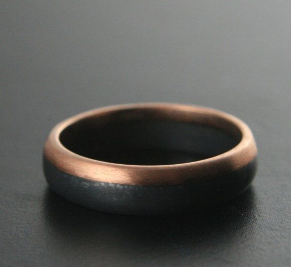 This ring is handforged in 14K Rose Gold and Sterling Silver and measures 6mm wide. It has been given a curved outer surface, and the 14K Rose Gold