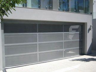 Custom Contemporary Garage Door Designs   Perfalite 42   42% perforated sheeting used with a custom designed aluminium frame.