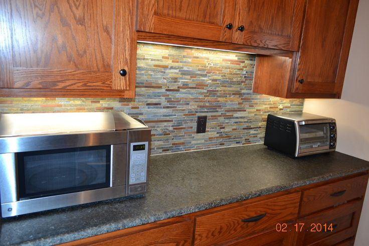 Jeffrey Court copper and slate backsplash; love; our L-shaped kitchen has this butler pantry area hidden from view.  Pantry, refrigerator, microwave,, toaster oven, countertop workspace and tons of storage are in here