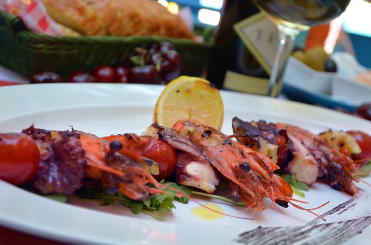 Prawn and octopus skewer with zucchini and cherry tomatoes