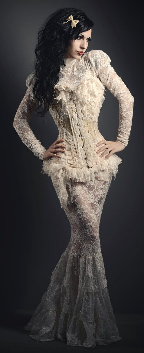How to recreate this Neo-Victorian Wedding Dress (white lace wedding gown with leg of mutton sleeves, mermaid/fishtail skirt and high collar with white lace overbust corset) for Steamgoth, Goth, or gothic brides - For costume tutorials, clothing guide, fashion inspiration photo gallery, calendar of Steampunk events, & more, visit SteampunkFashionGuide.com