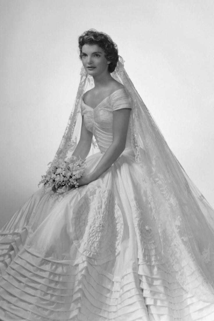 Jackie Kennedy | Jackie's gown is everything. We could look at beautiful wedding gowns all day, every day, and this collection has some stunners. We're starting our list with Wallis Simpson's stunning slip-of-a-gown that was at the height of fashion in 1937 when she married the Duke of Windsor. Other royals that made our list are Grace Kelly, Queen Elizabeth, Princess Margaret, Kate Middleton, and—of course, Princess Diana and her over-the-top confection for her 1981 nuptials to Prince