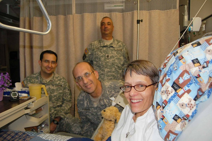 Maj. Escobedo, left, WSMR Command Sgt. Maj Felipe Paul, top center, and Installation Commander, Brig. Gen. John Ferrari, bottom center, pose for a photo with Buddy Hayes, a patient at the Albuquerque VA Hosptial. The Command Group took time to visit with patients during their visit to the facility, Jan. 25, 2012.