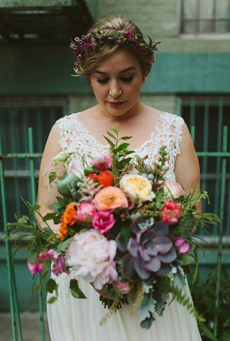 Multicolored Succulents, Roses, Peonies, and Thistle Bouquet. Quinn and Tim wanted to showcase their Williamsburg neighborhood throughout their rooftop wedding in Brooklyn, New York. The bride toted a boho-inspired arrangement of succulents, garden roses, peonies, and thistle, created by Sprout Home.