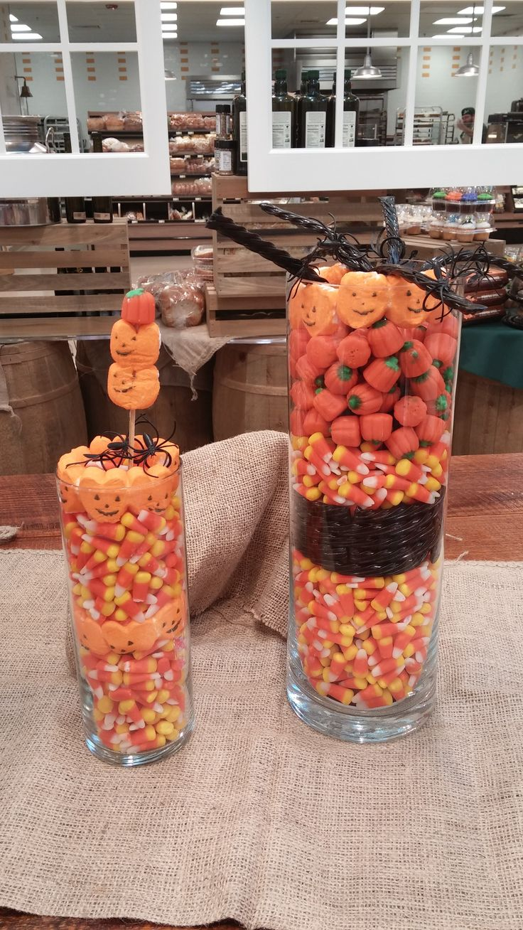 Centerpieces made with Halloween candy...will disappear quickly off the table if you've got kids in the house.  Rosanne used candy corn in a tall vase.