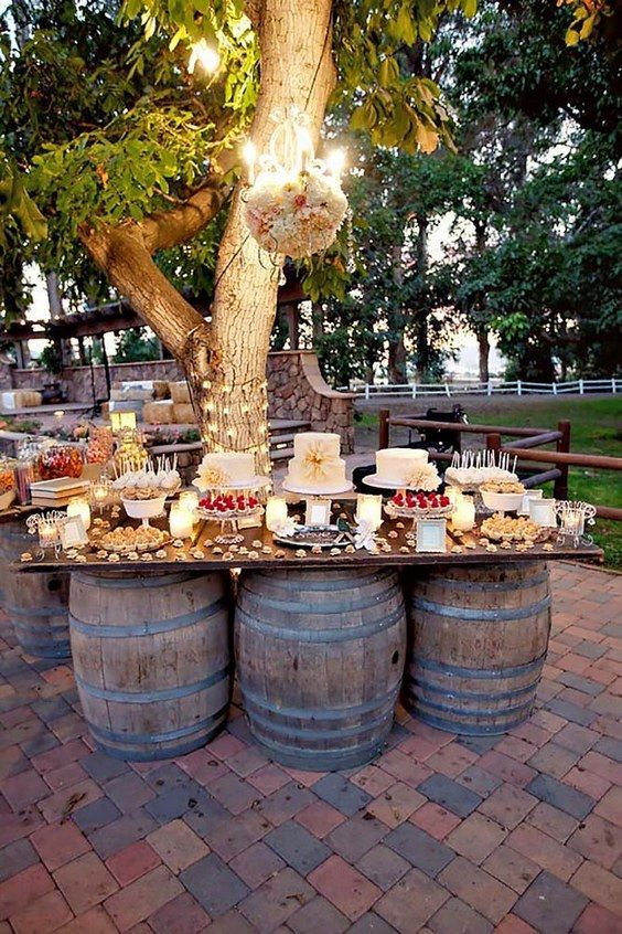 country wine barrel wedding dessert table ideas / http://www.himisspuff.com/wedding-dessert-tables-displays/4/