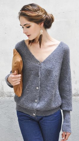 grey color v shaped sweater and jeans