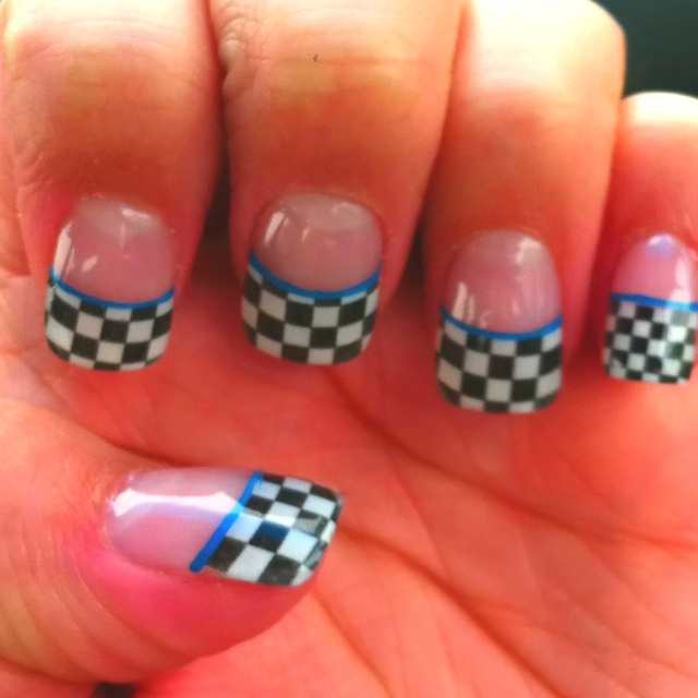 Checkered flag tips for race season :) and its matts colors :) might have to go get my nails done :0)