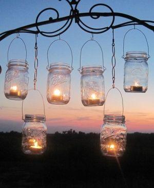 love these homemade mason jar lanterns hanging from scrolled metal: Ball Jars, Ideas, Masons, Parties, Teas Lights, Mason Jars Lanterns, Mason Jars Candles, Jars Lights, Masonjar
