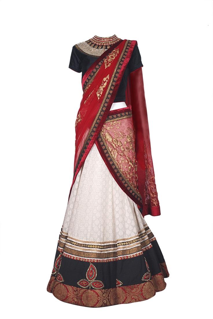 A black maharani neck blouse with a minimal white lehenga