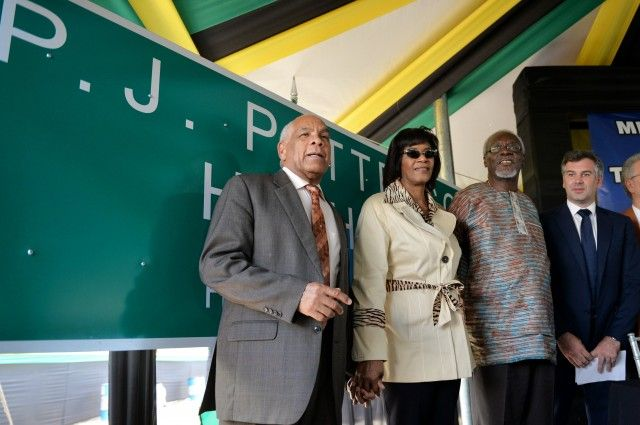 Prime Minister, the Most Hon. Portia Simpson Miller (2ndleft), and former Prime Minister, the Most Hon. P.J. Patterson (2nd right), along with Transport, Works, and Housing Minister, Dr. the Hon. Omar Davies (left), and Managing Director TransJamaican Highway, Guillaume Allain, stand in front of the sign bearing the new name of the Kingston to May Pen segment of Highway 2000, which was unveiled during Friday's (April 17) renaming ceremony, at the corridor's Old Harbour Interchange in St…