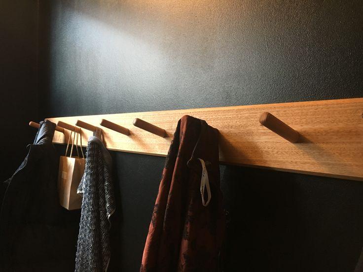 usethings recycled hardwood coat rack on black wall