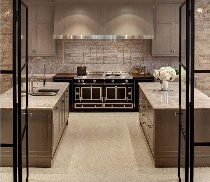 a chic entrance welcomes you to this sophisticated kitchen feat nuhauss custom cabinetry la cornue - La Cornue Kitchen Designs