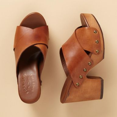 """KORK EASE® GABI CLOGS--Classic wooden clog construction by Kork-Ease®, updated with a 3-3/4"""" chunky heel on a 1-1/4"""" platform. Italian leather cross-band uppers with nailhead detail. Rubber forepart and heel cap. Imported. Whole sizes 6 to 11.View our entire Kork-Ease Collection."""