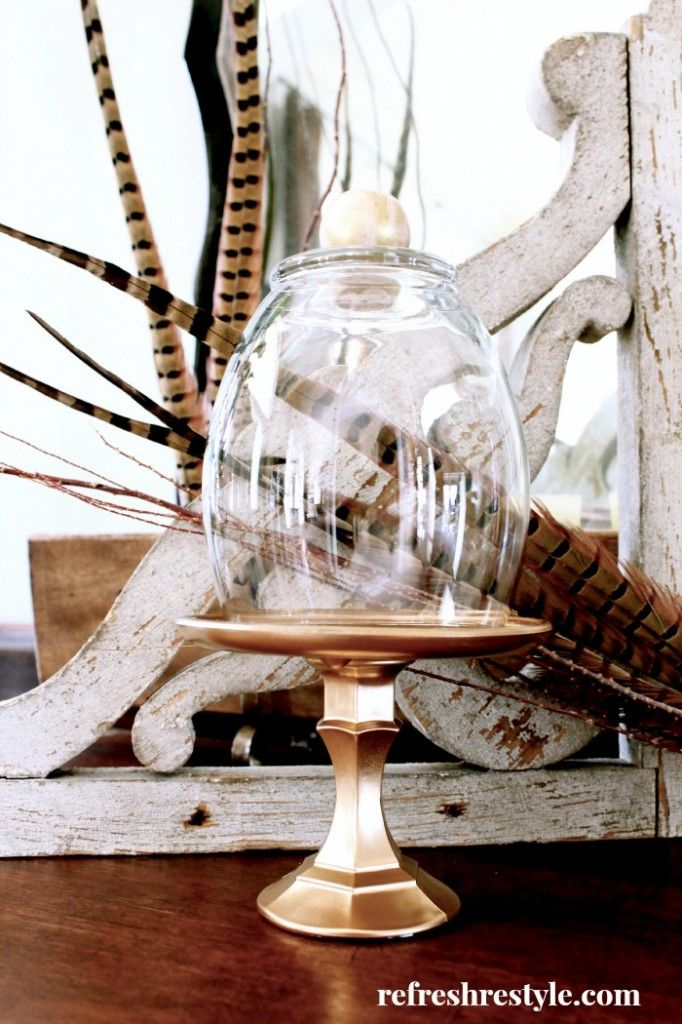 Dollar store cloche... Candlestick holder, plate, vase, wooden know, and gold spray paint. Awesome!