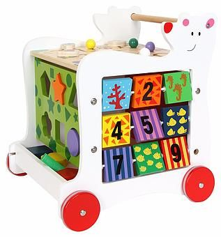 A range of wooden rattles, grasping toys, mobiles and money boxes for babies and young children from Wood and Wonder