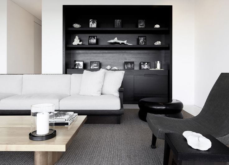 Black cabinetry recessed in white wall